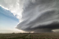 Landscape with massive supercell in the Eastern Texas panhandle, USA. Massive baseball-sized hail fell with this storm - ISF21514