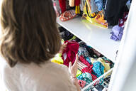 Woman clearing her wardrobe - AFVF03279