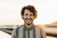 Portrait of laughing man at sunset - AFVF03351