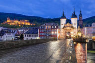 Historic old town with bridge gate and Heidelberg Castle in the evening, Heidelberg, Baden-Wuerttemberg, Germany - HNF00814