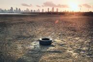 Discarded tyre on seashore, Costa del Este, Ciudad de Panamá, Panama - CUF51453