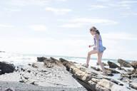 Girl exploring beach - CUF51483