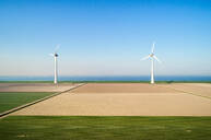 Coastal wind turbines and field landscape in spring, elevated view, Urk, Flevoland, Netherlands - CUF51615