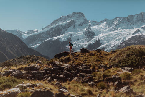 Hiker exploring wilderness, Wanaka, Taranaki, New Zealand - ISF21844