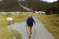 Hiker walking on trail path, Wanaka, Taranaki, New Zealand - ISF21853