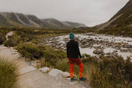 Hiker enjoying view of wilderness, Wanaka, Taranaki, New Zealand - ISF21868