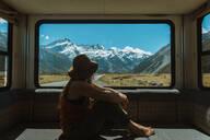 Woman enjoying view from inside motorhome, Wanaka, Taranaki, New Zealand - ISF21877