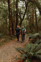 Parents with baby exploring forest, Queenstown, Canterbury, New Zealand - ISF21904
