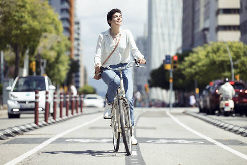 Woman with bike on bicycle lane - JSRF00347