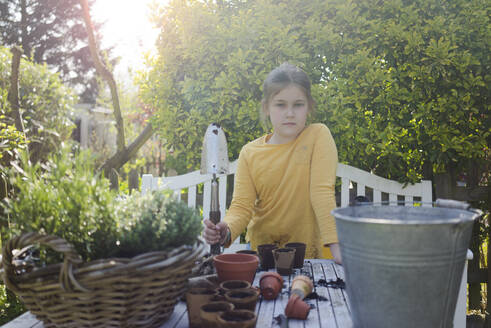 Portrait of girl gardening - MOEF02279