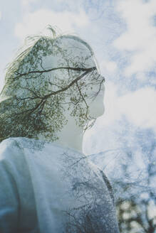 Double exposure of girl and sky with trees and clouds - IHF00146