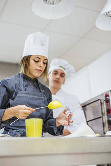 Junior chefs prepairing a dessert - LJF00174