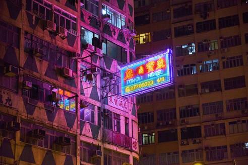 Lighted neon sign of a hotel at night, Kowloon, Hong Kong, China - MR02093