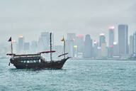 View to Victoria harbour with sailing ship in the foreground, Hong Kong, China - MRF02096