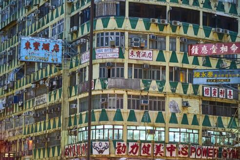 Facade and signs, Kowloon, Hong Kong, China - MRF02108