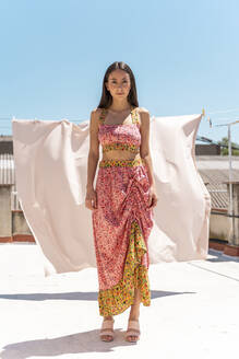 Portrait of woman wearing fashionable top and skirt on roof top - AFVF03437