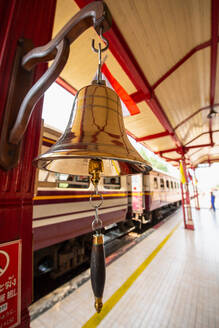 Traditional brass bell on station platform in Hua Hin, Thailand - CUF51620