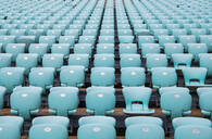 Rows of blue seats at empty open air stadium - CUF51788