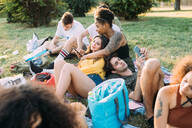 Group of friends relaxing at picnic in park - CUF51905