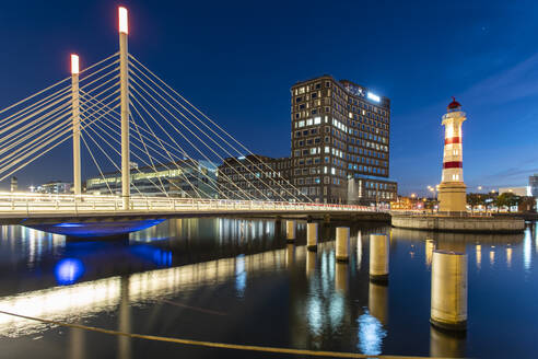 Universitetsbron with Malmo Old Light House and University Orkanen Library at night - TAMF01676