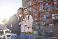 Happy couple at backlight, Barcelona, Spain - DVGF00044