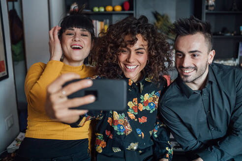 Friends taking selfie at home - CUF52253