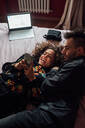 Couple using smartphone on bed - CUF52277