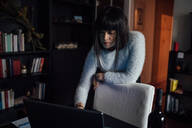 Woman using laptop in home office - CUF52283