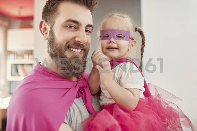 Father and daughter playing super hero and superwoman - ZEDF02506 - Zeljko Dangubic/Westend61