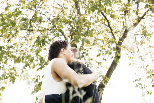 Pregnant bride and her husband  on a meadow - HMEF00477