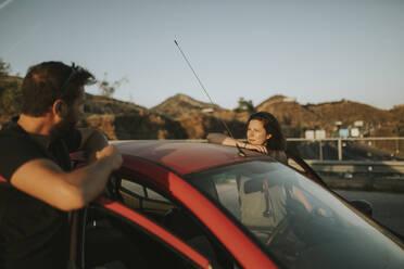 Happy couple on road trip, taking a break - DMGF00071
