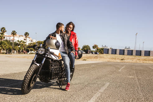 Couple sitting on motorbike - LJF00318