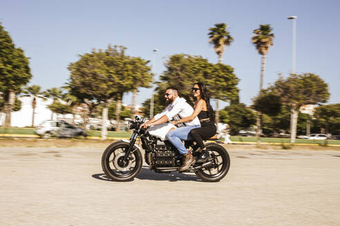 Couple riding on motorbike in summer - LJF00321