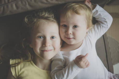 Two happy little sister head to head - IHF00162