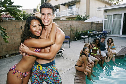 Couple hugging near swimming pool - BLEF08264
