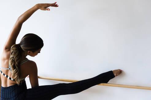 Mixed race dancer practicing in studio - BLEF08525
