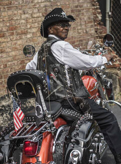 Senior African American man riding motorcycle - BLEF08655