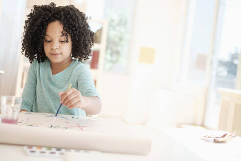 African American girl painting with watercolors - BLEF08741