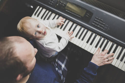 Father playing keybord with his little daughter, top view - IHF00168
