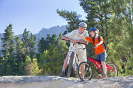 Grandfather and Grandson on mountain bikes - JUIF02147