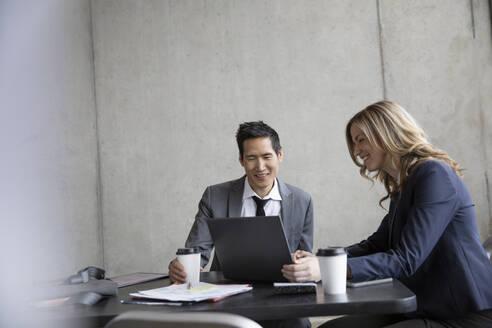 Business people meeting, using digital tablet at table - HEROF36999