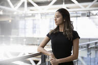 Ambitious, forward looking young businesswoman on office balcony - HEROF37053