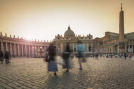 Blurred view of people walking in Saint Peters Square, Rome, Lazio, Italy - BLEF09395