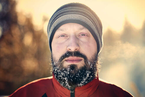 Caucasian man with snow in beard - BLEF09469