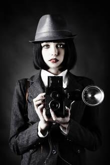 Caucasian photographer using vintage camera - BLEF09478