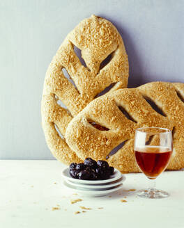 Homemade leaf shaped ciabatta bread with olives and red wine - PPXF00200
