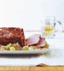 Kasseler with sauerkraut and grapes in table - PPXF00209