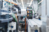 Intricate machinery inside modern factory, Stuttgart, Germany - DIGF07169