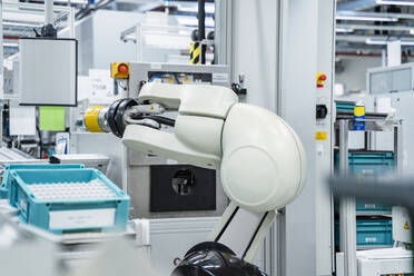 Arm of assembly robot functioning inside modern factory, Stuttgart, Germany - DIGF07178