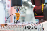 Arm of assembly robotpicking up machine part, Stuttgart, Germany - DIGF07199